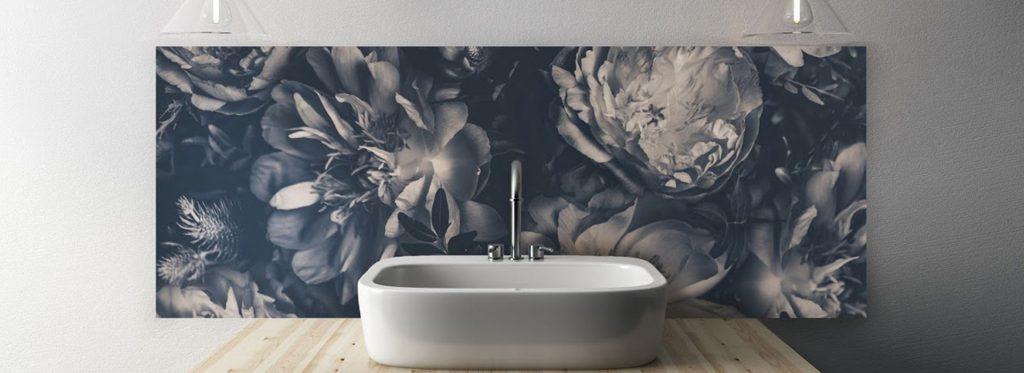 purple toned grey scale flower patterned splashback in a simplistic bathroom sink setting.