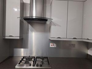 silver aluminium splashback in kitchen
