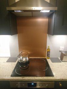 copper splashback behind hob