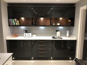 copper and silver splashback in kitchen
