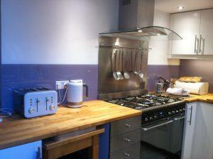 purple splashback in kitchen