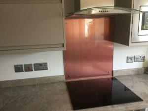 Copper Splashbcak Behind Hob in Kitchen