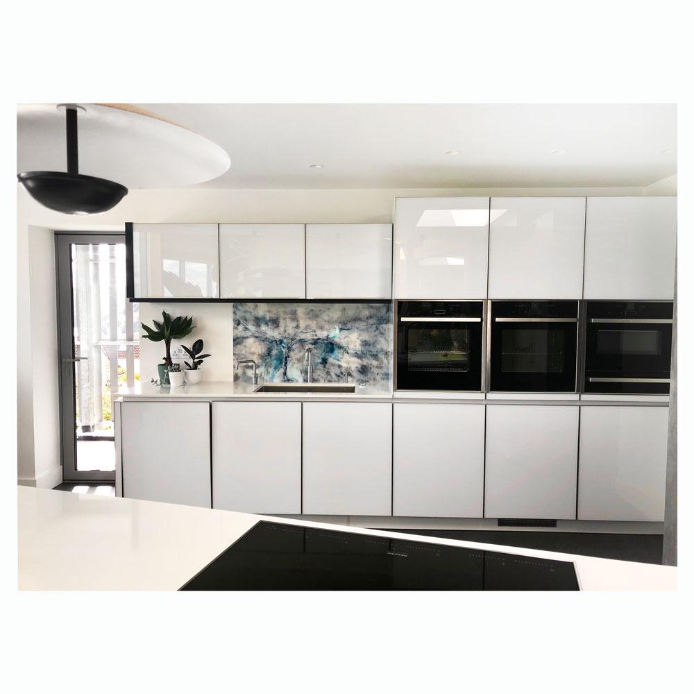 modern kitchen with blue abstract acrylic splashback.