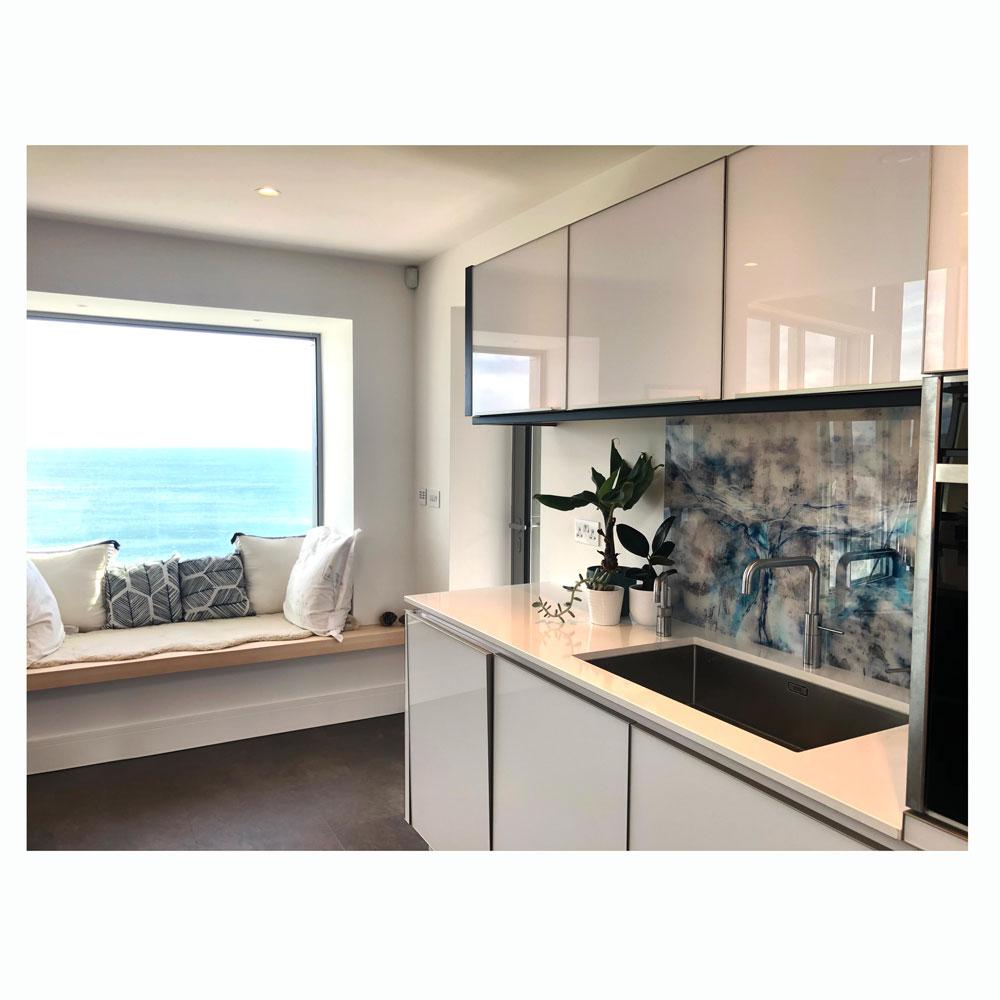 seaside kitchen with bespoke acrylic splashback.